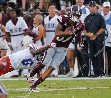 Mississippi State wide receiver Osirus Mitchell (87) is tackled by Florida defensive back Brian Edwards (6) during the first half of their NCAA college football game in Starkville, Miss., . Florida won 13-6