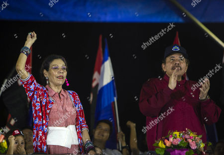 Nicaraguan President Daniel Ortega (R) participates with his wife and vice president Rosario Murillo (L) in a public event after thousands of Sandinista supporters held a walk called 'Death to Somozism' in Managua, Nicaragua, 29 September 2018. The Nicaraguan president's support comes amidst a sociopolitical crisis that, according to humanitarian agencies, has left between 322 and 512 dead, mainly in protests.