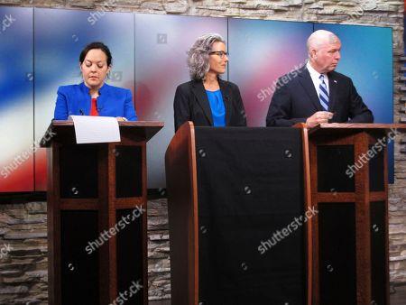 From left, Libertarian Elinor Swanson, Democrat Kathleen Williams and Republican U.S. Rep. Greg Gianforte wait for a Montana U.S. House debate to begin, in Helena, Mont