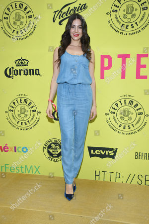 Stock Image of Aroa Gimeno Poses for photos during the red carpet of 'September Fest' Beer Festival to promote the Mexican beer at Deportivo Lomas Altas on September 29, 2018 in Mexico City, Mexico