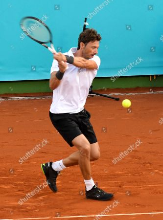 Stock Image of Spanish former tennis player Juan Carlos Ferrero returns the ball to Russian Marat Safin during the final of the Masters Seniors Tennis Tournament in which several tennis legends took part at Manolo Santana de Puente Romano facilities in Malaga, Andalusia, Spain, 29 September 2018 (issued 30 September 2018).