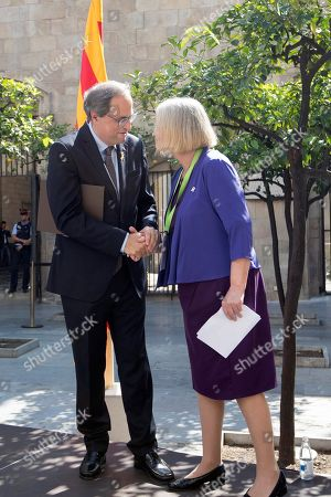 Catalan regional President, Quim Torra (L), greets Former Presiding Officer of the Scottish Parliament, Tricia Marwick (R), during a ceremony held in support to those affected by the police actions during the illegal pro-independence referendum a year ago in Barcelona, Spain, on occasion of its first anniversary, 30 September 2018. On 01 October 2017, Catalonia held an illegal pro-independence referendum that led to a political crisis and the detention of various pro-independence civil leaders and politicians that still remain in jail awaiting trial. Other politicians remain abroad after they fled a year ago to avoid prison.