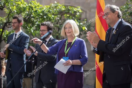 Stock Image of Catalan regional President, Quim Torra (R), and Former Presiding Officer of the Scottish Parliament, Tricia Marwick (2R), attend a ceremony held in support to those affected by the police actions during the illegal pro-independence referendum a year ago in Barcelona, Spain, on occasion of its first anniversary, 30 September 2018. On 01 October 2017, Catalonia held an illegal pro-independence referendum that led to a political crisis and the detention of various pro-independence civil leaders and politicians that still remain in jail awaiting trial. Other politicians remain abroad after they fled a year ago to avoid prison.
