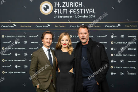 German actors Tom Schilling (L), Saskia Rosendahl (C) and Sebastian Koch (R) pose on the Green Carpet before the screening of 'Never Look Away' (Werk ohne Autor) during the 14th Zurich Film Festival (ZFF), in Zurich, Switzerland, 30 September 2018. The festival runs from 27 September to 07 October.