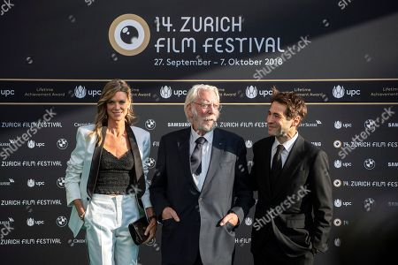 Canadian actor Donald Sutherland (C) poses with co-director Nadja Schildknecht (L) and Zurich Film director Karl Spoerri (R) on the Green Carpet before the screening of 'Ella and John' during the 14th Zurich Film Festival (ZFF), in Zurich, Switzerland, 30 September 2018. The festival runs from 27 September to 07 October.