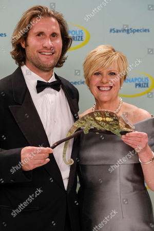 Max Graham, Anne Thompson. Hosts Max Graham, left, and Anne Thompson pose with a Parson's chameleon at the 2018 Indianapolis Prize Gala at the JW Marriott, in Indianapolis