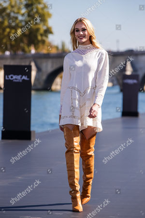 Greek TV host Doukissa Nomikou presents a creation as part of a fashion show organized by cosmetics company L'Oreal on the Seine, during the Paris Fashion Week, in Paris, France, 30 September 2018 (issued 01 October 2018). The presentation of the Women's collections runs from 24 September to 02 October.