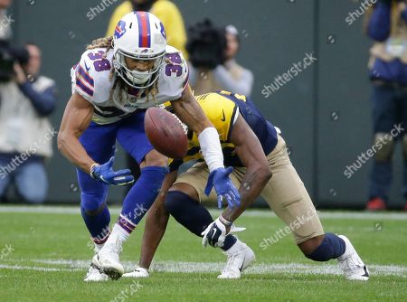 Buffalo Bills' Ryan Lewis breaks up a pass intended for Green Bay Packers' Marquez Valdes-Scantling during the second half of an NFL football game, in Green Bay, Wis