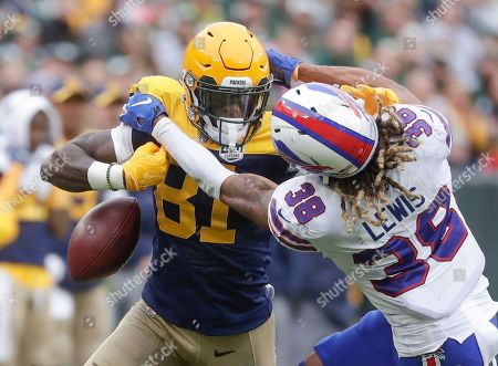Green Bay Packers' Geronimo Allison drops the ball as he iOS hit b Buffalo Bills' Ryan Lewis during the first half of an NFL football game, in Green Bay, Wis. The ball went out of bounds