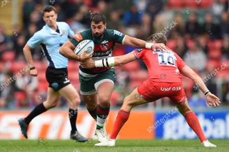 Gareth Owen of Leicester Tigers fends AJ MacGinty of Sale Sharks