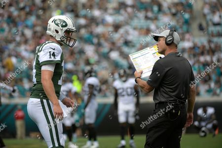 New York Jets quarterback Sam Darnold (14) talks with offensive coordinator Jeremy Bates during the first half of an NFL football game against the Jacksonville Jaguars, in Jacksonville, Fla