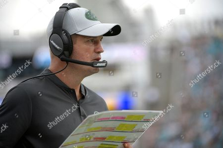 New York Jets offensive coordinator Jeremy Bates works from the sideline during the second half of an NFL football game against the Jacksonville Jaguars, in Jacksonville, Fla. The Jaguars won 31-12