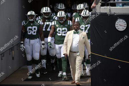 New York Jets offensive tackle Kelvin Beachum (68), offensive guard James Carpenter (77), defensive end Leonard Williams (92) and defensive end Nathan Shepherd (97), right, head out to the field with teammates before an NFL football game against the Jacksonville Jaguars, in Jacksonville, Fla