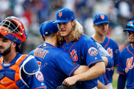 New York Mets' Noah Syndergaard is congratulated by teammate David Wright after pitching a complete-game shutout during a baseball game against the Miami Marlins, in New York