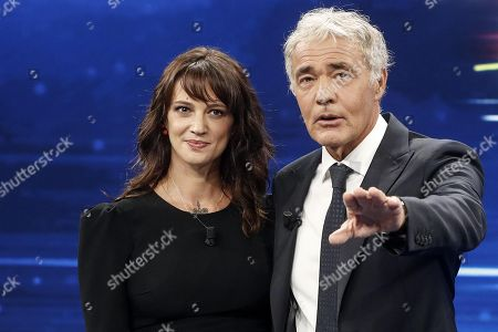 Stock Photo of Italian actress Asia Argento (L) during the Italian La7 TV program 'Non e l'Arena', conducted by Massimo Giletti (R), in Rome, Italy, 30 september 2018. According to reports, Argento was speaking about a scandal that broke out in August 2018 after she was accused of sexual assault by actor Jimmy Bennett in New York Times. Asia Argento denied any sexual contact with Bennett. Argento was among first women who publicly accused Harvey Weinstein of rape in October 2017.