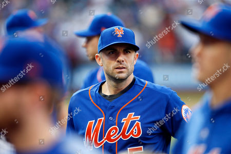 New York Mets' David Wright walks to the dugout after a baseball game against the Miami Marlins, in New York