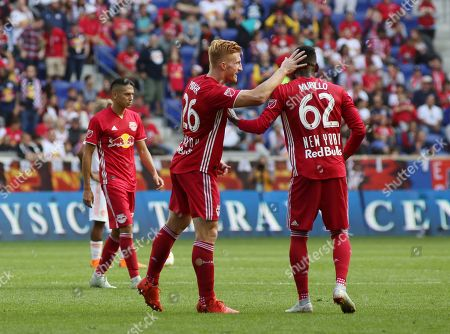 Michael Amir Murillo, Tim Parker. New York Red Bulls defender Michael Amir Murillo, right, congratulates New York Red Bulls defender Tim Parker after he scored a goal during the second half of an MLS soccer match against Atlanta United, in Harrison, N.J. The New York Red Bulls won 2-0