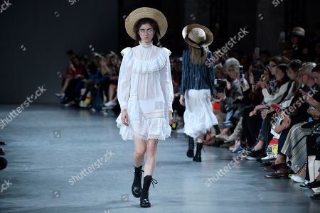 Stock Picture of A model presents a creation from the Spring/Summer 2019 Women's collection by British designer Bill Gaytten for John Galliano fashion house during the Paris Fashion Week, in Paris, France, 30 September 2018. The presentation of the Women's collections runs from 24 September to 02 October.