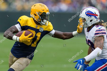 Green Bay Packers wide receiver Geronimo Allison #81 stiff arms Buffalo Bills defensive back Ryan Lewis #38 during the NFL Football game between the Buffalo Bills and the Green Bay Packers at Lambeau Field in Green Bay, WI. Green Bay defeated Buffalo 22-0