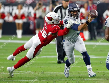 Arizona Cardinals quarterback Josh Rosen (3) gets the throw off as Arizona Cardinals defensive back Budda Baker (36) makes the hit during the first half of an NFL football game, in Glendale, Ariz