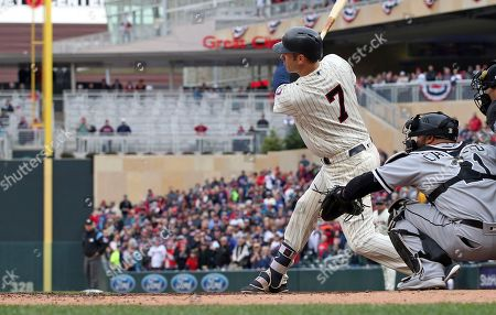 Minnesota Twins' Joe Mauer, the subject of retirement talk, watches his double off Chicago White Sox pitcher Juan Minaya in the seventh inning of a baseball game, in Minneapolis. The Twins won 5-4