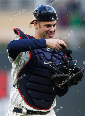 Minnesota Twins' Joe Mauer, the subject of retirement talk, donned catcher's gear and caught for one pitch against a Chicago White Sox batter in the ninth inning of a baseball game, in Minneapolis. Mauer began his career as a catcher before switching to first base. The Twins won 5-4