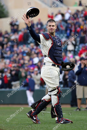 Minnesota Twins' Joe Mauer, the subject of retirement talk, donned catcher's gear and caught for one pitch against a Chicago White Sox batter in the ninth inning of a baseball game, in Minneapolis. Mauer began his career as a catcher before switching to first base