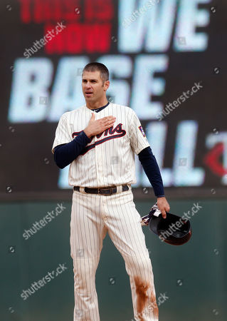 Minnesota Twins' Joe Mauer, the subject of retirement talk, acknowledges a standing ovation after he doubled against the Chicago White Sox batter in the ninth inning of a baseball game, in Minneapolis. The Twins won 5-4