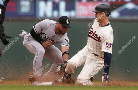 Joe Mauer, Yoda Moncada. Minnesota Twins' Joe Mauer, right, beats the tag by second baseman Yoda Moncada to double in the seventh inning of a baseball game, in Minneapolis. The Twins won 5-4