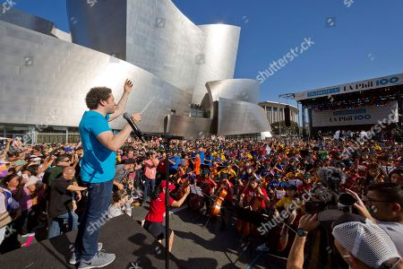 LA Phil Music & Artistic Director Gustavo Dudamel, conducts musicians from the LA Phil, Youth Orchestra Los Angeles (YOLA) at the Celebrate LA: LA Phil 100 x CicLAvia event outside the Walt Disney Concert Hall downtown Los Angeles . About 8 miles (13 kilometers) miles of streets stretching from downtown Los Angeles to the Hollywood Bowl are closed to motor vehicles Sunday as the city's latest celebration of the CicLAvia festival opens the lanes to bicyclists
