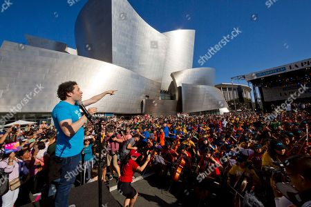 Los Angeles LA Phil Music & Artistic Director Gustavo Dudamel, conducts musicians from the LA Phil, Youth Orchestra Los Angeles (YOLA) at the Celebrate LA: LA Phil 100 x CicLAvia event outside the Walt Disney Concert Hall downtown Los Angeles . About 8 miles (13 kilometers) miles of streets stretching from downtown Los Angeles to the Hollywood Bowl are closed to motor vehicles Sunday as the city's latest celebration of the CicLAvia festival opens the lanes to bicyclists