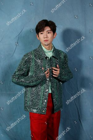 Roy Wang poses for photographers upon arrival at the Givenchy Spring/Summer 2019 ready to wear fashion collection presented in Paris