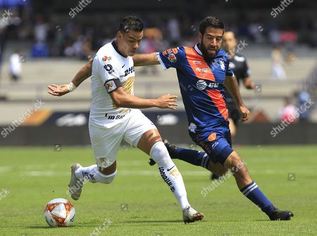 Pumas' Pablo Barrera (L) vies for the ball with Puebla's Pablo Gonzalez (R) during their Apertura tournament soccer match at Olympic stadium in Mexico City, Mexico, 30 September 2018.