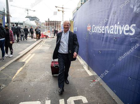 David Willetts outside conference at the start of day 1 of the Conservative Party conference at the ICC in Birmingham.