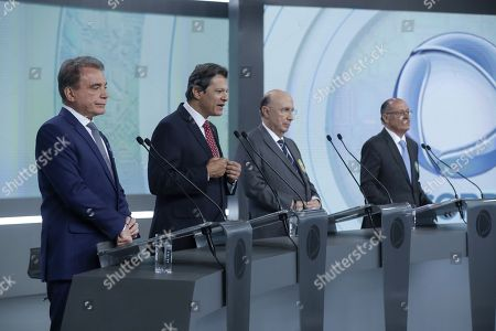 Stock Photo of (L-R) Brazilian Presidential candidates Alvaro Dias of the Podemos Party, Fernando Haddad of the Workers' Party (PT), Henrique Meirelles of the Partido Movimiento Democratico Brasileno (PMDB) and Geraldo Alckmin of the Social Democracia Brasilena Party (PSDB) participate in a televised Presidential debate with the other candidates organized by RecordTV in Sao Paulo, Brazil, 30 September 2018.