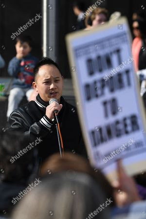 Paul Lee, partner of Huyen Tran, addresses a crowd outside the Federal Circuit Court in Melbourne, Australia, 01 October 2018. A demonstration has been called against the impending deportation of a Vietnamese Catholic asylum seeker Huyen Tran, who is facing separation from her family.