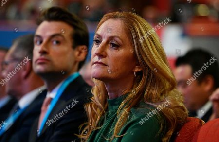 Susan Williams-Walker (R) the wife of Britain's Chancellor of the Exchequer Phillips Hammond (unseen) listens to her husband's speech on the second day of the Conservative Party Conference in Birmingham, Britain, 01 October 2018. The Conference runs from 30 September to 03 October 2018.