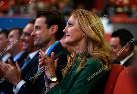 Susan Williams-Walker (R) the wife of Britain's Chancellor of the Exchequer Phillips Hammond (unseen) applauds her husband's speech on the second day of the Conservative Party Conference in Birmingham, Britain, 01 October 2018. The Conference runs from 30 September to 03 October 2018.