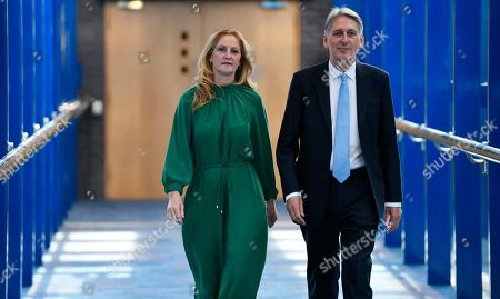 Britain's Chancellor of the Exchequer Phillips Hammond (R) and his wife Susan Williams-Walker arrive before his speech on the second day of the Conservative Party Conference in Birmingham, Britain, 01 October 2018. The Conference runs from 30 September to 03 October 2018.