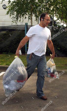 Michael Biggs carrying his father's belongings