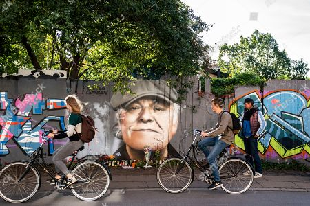 Flowers, beers, and greetings are laid in front of a portrait of Danish singer Kim Larsen painted on a fence towards Christiania on Princess Street in Copenhagen, Denmark, 01 October 2018. According to media reports, Larsen has died on 30 September 2018. He was 72.