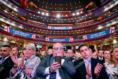 Eric Pickles (centre) and delegates in the symphony hall.