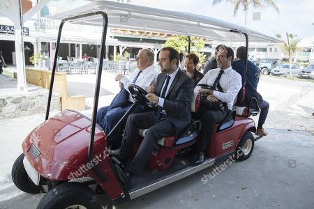 Stock Image of French ministers Sebastien Lecornu, Jacques Mezard and Annick Girardin arrive with a caddy at their visit to Baie Orientale (Orient Bay), on the French Caribbean island of Saint-Martin, as part of a four day visit to the french Antilles