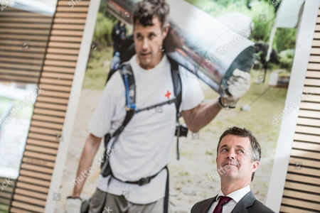 Stock Photo of Crown Prince Frederik of Denmark smiles during his visit to the Red Cross 'Volunteer House' in Copenhagen, Denmark, 01 October 2018, in connection with the crown prince becoming a Protector of Denmark's Red Cross. The Crown Prince takes over the position from his late father, Prince Henrik, who was protector of Denmark's Red Cross for 17 years.