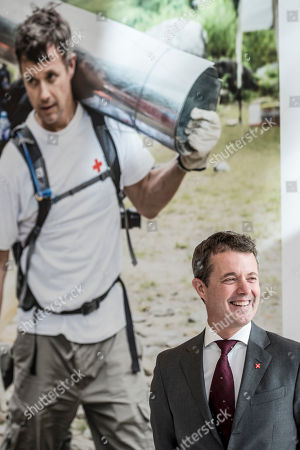 Stock Image of Crown Prince Frederik of Denmark smiles during his visit to the Red Cross 'Volunteer House' in Copenhagen, Denmark, 01 October 2018, in connection with the crown prince becoming a Protector of Denmark's Red Cross. The Crown Prince takes over the position from his late father, Prince Henrik, who was protector of Denmark's Red Cross for 17 years.