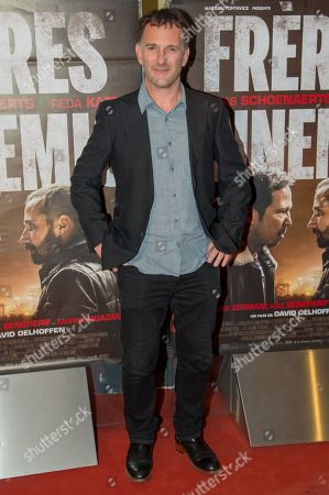 Stock Photo of French director David Oelhoffen attends Freres Ennemis premiere in Paris at UGC Cine Cite Les Halles.