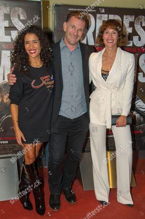 Stock Image of Sabrina Ouazani, David Oelhoffen and Gwendolyn Gourvenec attend Freres Ennemis premiere in Paris at UGC Cine Cite Les Halles.
