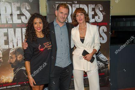 Sabrina Ouazani, David Oelhoffen and Gwendolyn Gourvenec attend Freres Ennemis premiere in Paris at UGC Cine Cite Les Halles.