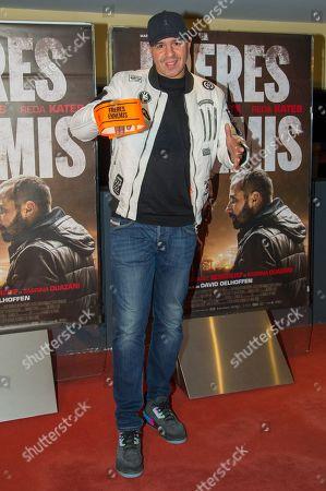 DJ Cut Killer attends Freres Ennemis premiere in Paris at UGC Cine Cite Les Halles.