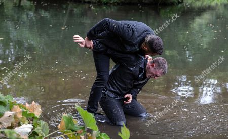 Stock Picture of Ep 8282 Wednesday 10th October 2018 Ross Barton, as played by Michael Parr, and Simon, as played by Liam Ainsworth, are finally alone and facing up to one another. Ross is about to attack him when Moira Dingle, arrives Ross however is undeterred and drags Simon to the edge of the lake. How will this end and will Ross get the truth he deserves from Simon?